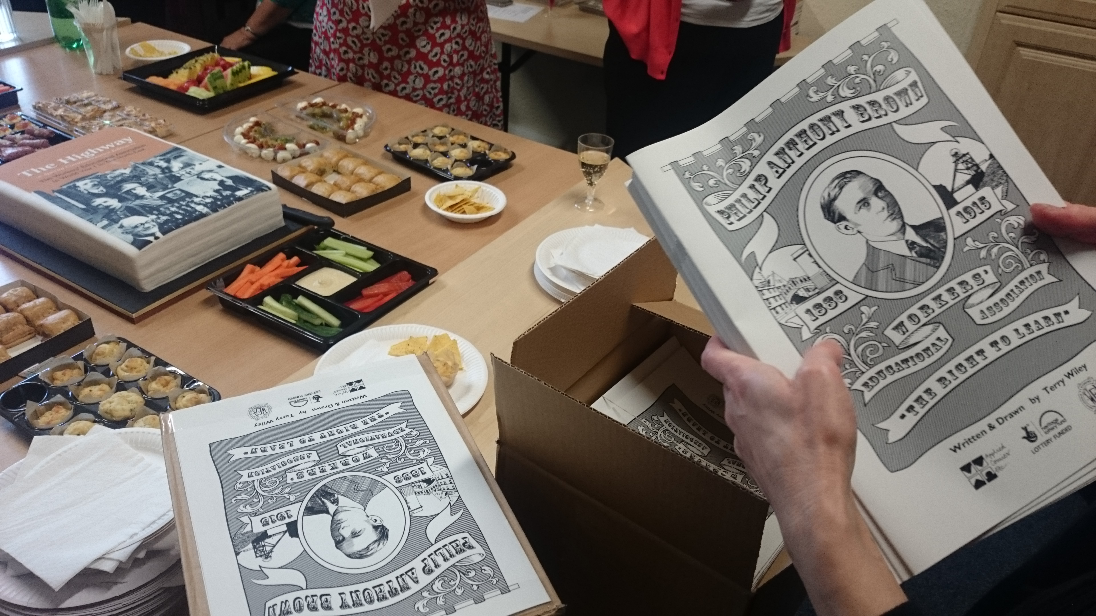 Unboxing 'The Right To Learn' comic at the WEA's project launch party